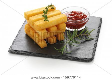 fried polenta with dipping sauce isolated on white background