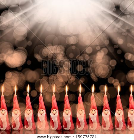 Christmas, several Santa Clause candles in a row
