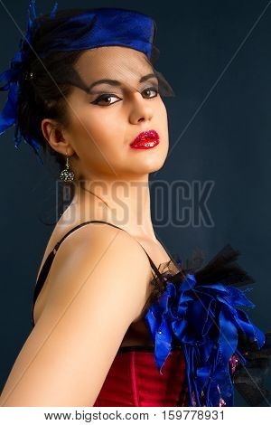 Sexy young woman in fashion dress on a dark background