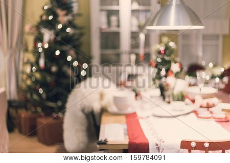 Abstract blurry of home decorated christmas dining table