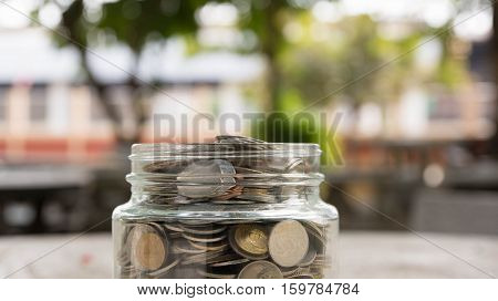 save money concept, save money piggy and Putting coin in piggy bank
