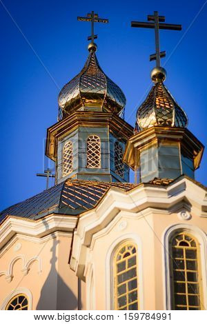 Ortodox church cupolas in the blue sky of the morning light