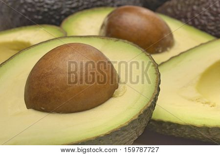 Studio shot of halved avocados