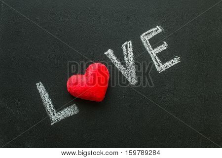 Love Hand writes on the chalk board. Valentine's day
