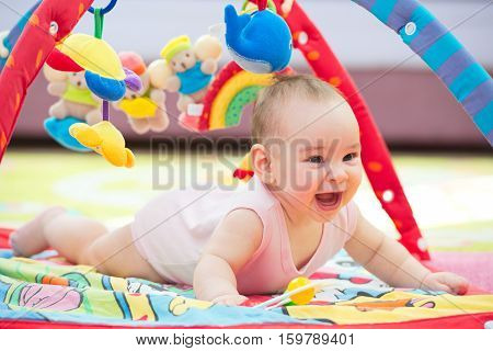 Sweet Baby Crawling And Playing With Toys On Carpet