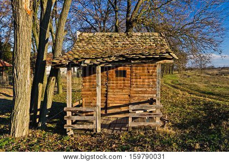 Retro wooden bus station at rural agricultural area of north Serbia