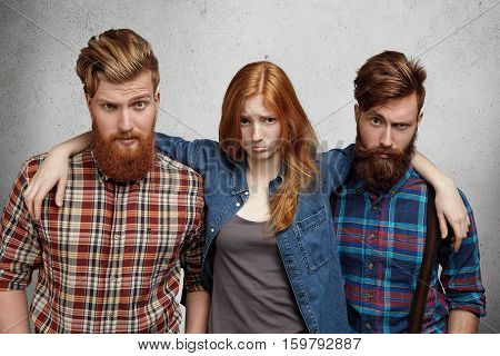 Love Triangle And Relationships. Beautiful Redhead Girl With Sad Unhappy Expression Pouting While St