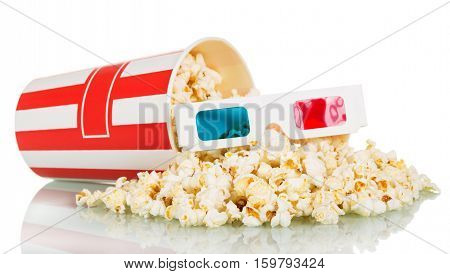 Popcorn spilled from the big box and 3D glasses isolated on a white background