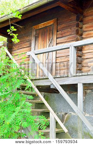 Finnish traditional sauna door and stairs in Finland