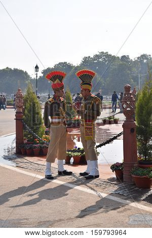 NEW DELHI, INDIA - FEBRUARY 02, 2016 - Two unidentified indian guards in uniform talking on the street nearby India gate