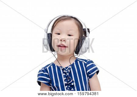 Little asian girl listening music by headphone