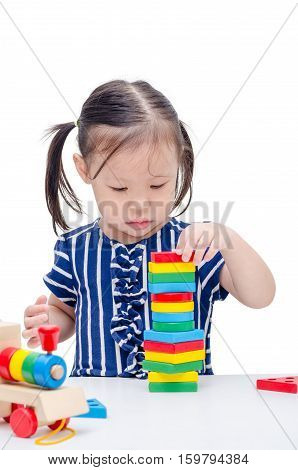 Little asian girl playing with colorful wood block