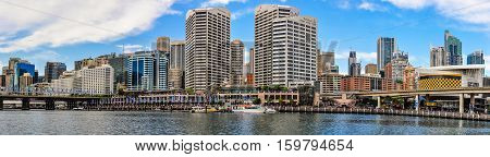 SYDNEY AUSTRALIA - AUGUST 29 2012: Panoramic view of the skyline in Darling Harbour in Sydney Australia