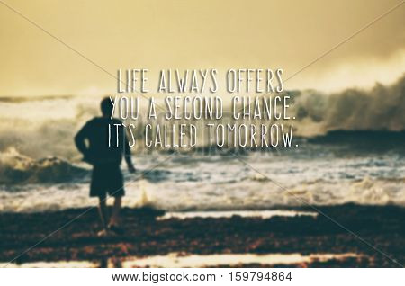 Inspirational Life Quote - Life Always Offers You A Second Chance. It's Called Tomorrow. Blurry And