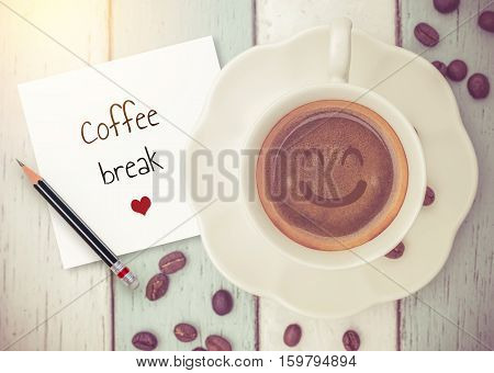 Text :Coffee break on paper with coffee cup on wood background