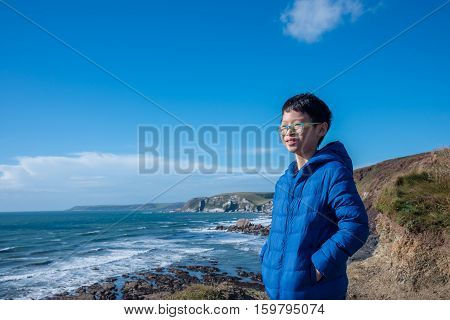 Young asian boy wearing jacket and smiling outdoor