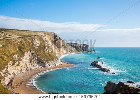 Beautiful cliff and beach with blue sky in sunshine day