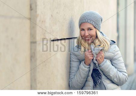 Pretty Blond Woman In Cool Blue Winter Fashion