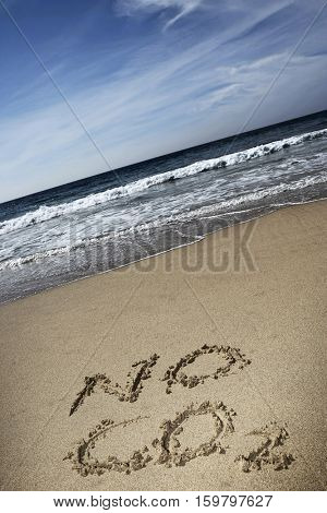 Elevated view of No CO2 written in the sand at beach