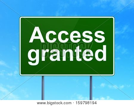 Safety concept: Access Granted on green road highway sign, clear blue sky background, 3D rendering