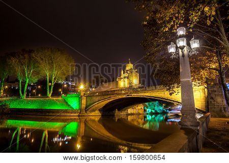 Night View Of The Church Of Metekhi And A Statue Vakhtang Gorgasali Over The River Mtkvari (kura), M