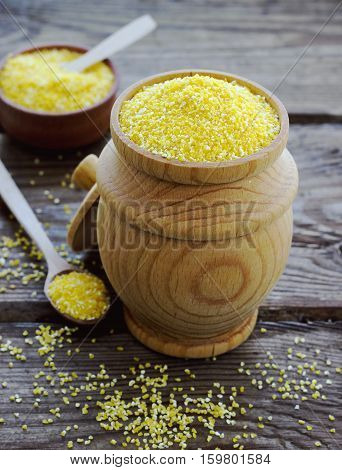 Raw Organic Polenta Corn Meal In A Wooden Bowl