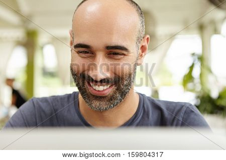 People, Technology And Leisure Concept. Headshot Of Good-looking Middle-aged Bearded Man Having Happ