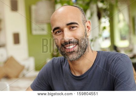 People And Lifestyle Concept. Happy Middle-aged Unshaven Man Wearing Casual T-shirt Looking At Camer