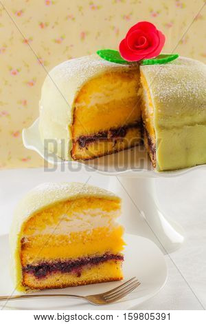 Typical Swedish princess cake marzipan birthday cake.