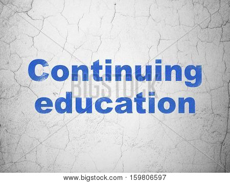 Education concept: Blue Continuing Education on textured concrete wall background