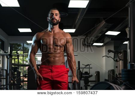 Fit Man Holding Weights In Hand