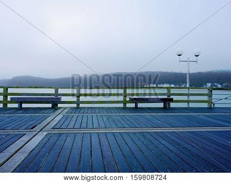 Autumn Misty Morning On Wooden Pier Above Sea. Depression, Dark  Atmosphere.