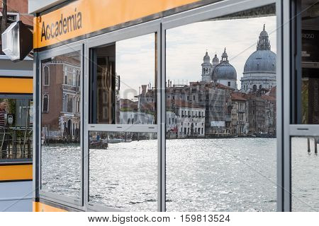 VENICE ITALY - SEPT 20 2016: Vaporetto stop Academia is one of a dozen ACTV vaporetto stops on No.1 line. Tourists can enjoy views of the historic palaces that face the water. Venice September 20 2016.