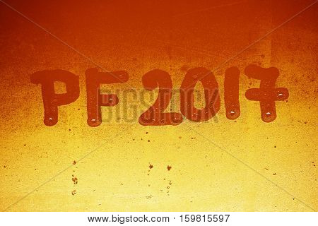 PF 2017 written on a misty window. Background for the celebration of the New Year 2017
