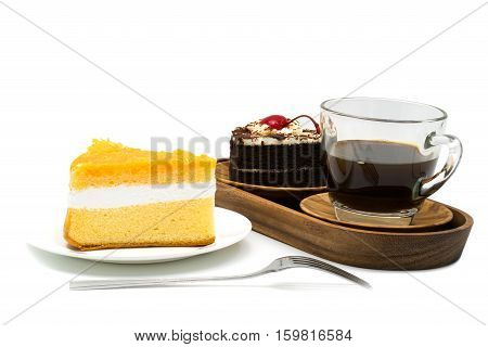 Chiffon cake in a white plate and a cup of coffee with chocolate cake in a wooden tray on white background