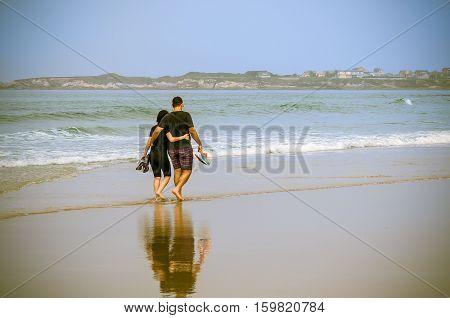 Romantic Stroll On The Beach
