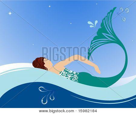 Beautiful mermaid swimming in ocean