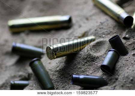 many shell casings from bullets of different caliber in the background chaos concept in the world