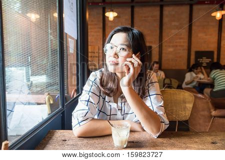 Woman Sitting In Loft Cafe Use Mobile Phone Business Connection