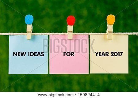 Sticky Color Papers With Word New Ideas For Year 2017 Hanging Against Green Background.