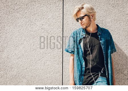 Hipster Man Listening Music Through Earphones