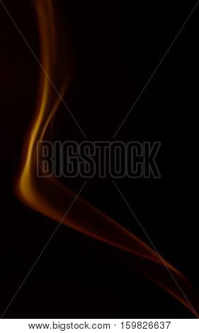 Orange abstract smoke art plume on a black background