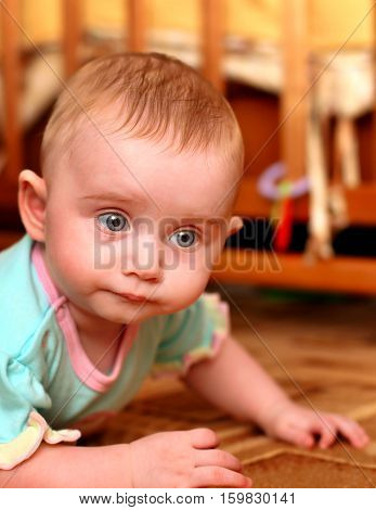 Small Baby on the Floor in Home Interior