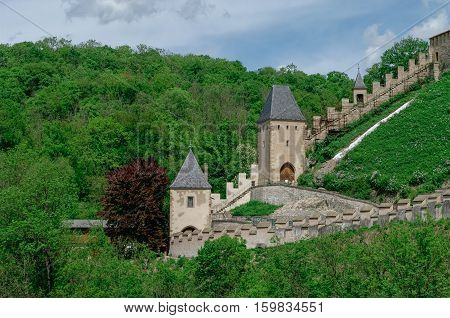 Towers And Walls Of Famous Medieval Karlstejn Castle Near Prague In Czech Republic