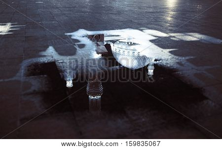 Mosque in the autumn puddle reflection. Conceptual photo