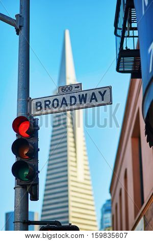 Red Traffic Light And Broadway Street Sign In San Francisco