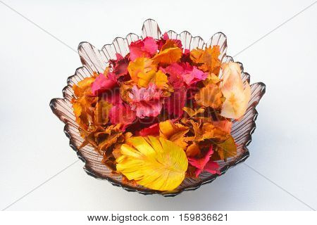 Bowl with potpourri on a white background