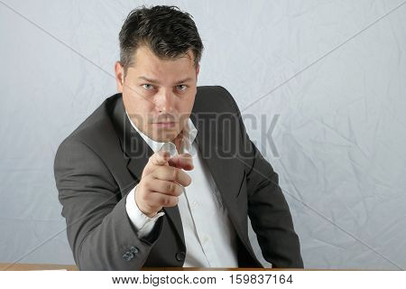 Young angry business man hand mimicry isolated