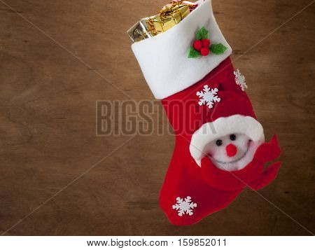 Christmas gifts for his boots isolated on white background