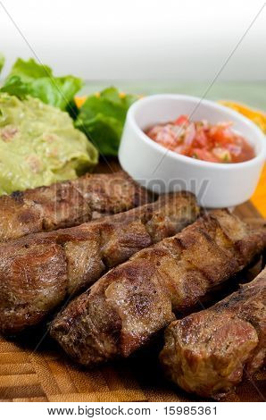 Ecuadorian food series: pork ribs with salad and pepper sauce